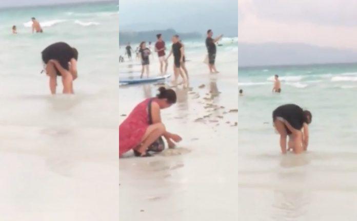 Philippines đóng cửa bãi biển vì khách Trung Quốc chôn tã xuống cát