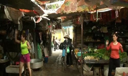 Morning workout at a Hanoi market