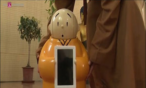 Chinese Buddhist temple disseminates wisdom with robot monk