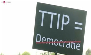 Protesters rally against Obama's free trade accord with EU