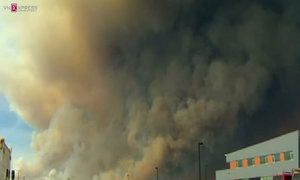 Thousands flee Canada wildfire