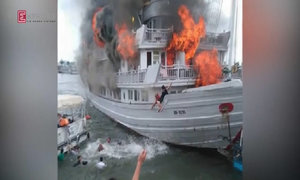 Passengers forced to abandon ship after fire rips through Ha Long Bay cruise boat