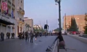 Amid protests, Greece passes painful fiscal reforms