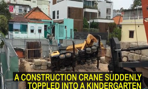 Children led screaming from school after crane truck topples inches from classroom