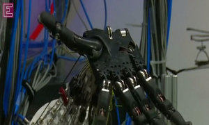 Robotic hand gets a human touch