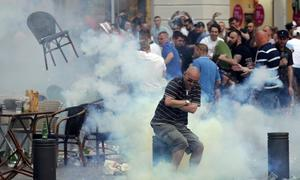French riot police disperse English and Russian fans in Marseille