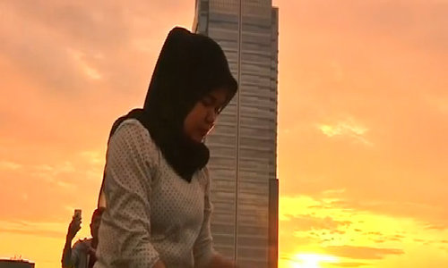 Yoga lovers take to helipad for sky-high sunrise workout in Indonesia