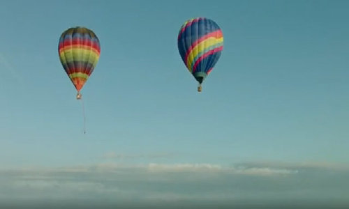 Daredevils reach for the clouds with sky-high swing
