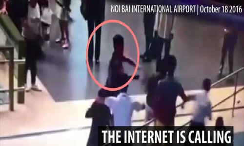 Man in black: Vietnam looks for mystery 'hero' who stopped airport assault