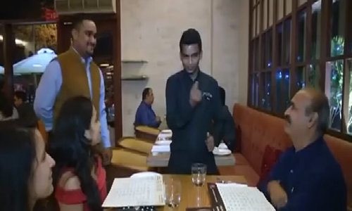 At Indian restaurant, deaf and mute staff a talking point