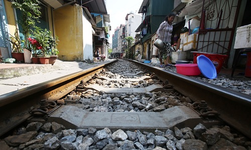 In Hanoi, train tracks are just your front yard