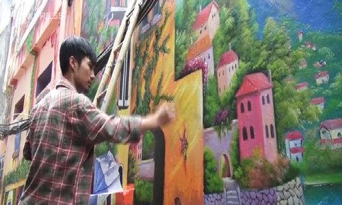 In Hanoi, street art means alley art