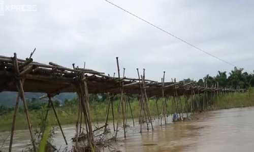 Thousands of lives dangle from a bamboo bridge in northern Vietnam