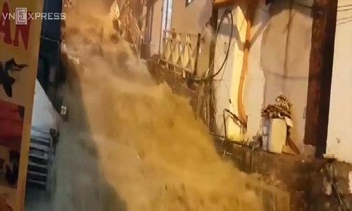 Raging torrents rip through resort town as storm ravages northern Vietnam