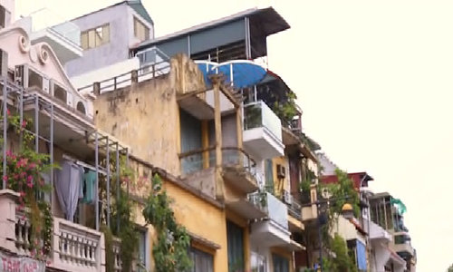 Looking up at the balconies of Hanoi