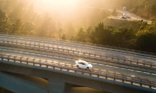 Tesla begins to deliver model for the masses