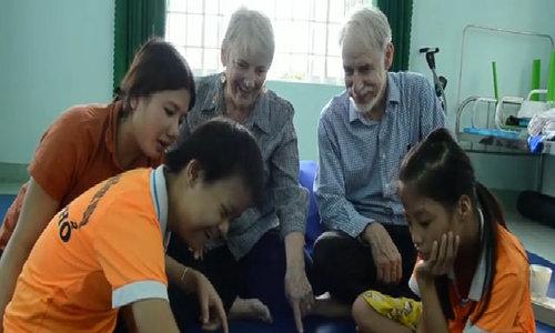 American couple teaching children of Agent Orange in central Vietnam
