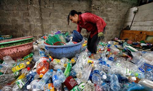 Trashed: 'Billionaire scrap village' residents die a slow death