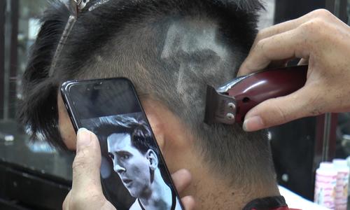 Vietnamese fans let their hair down in World Cup craze