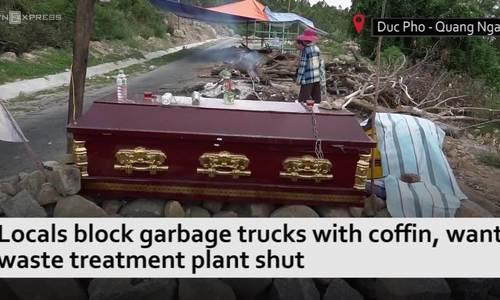 In central Vietnam, locals block garbage trucks with coffin, want treatment plant shut