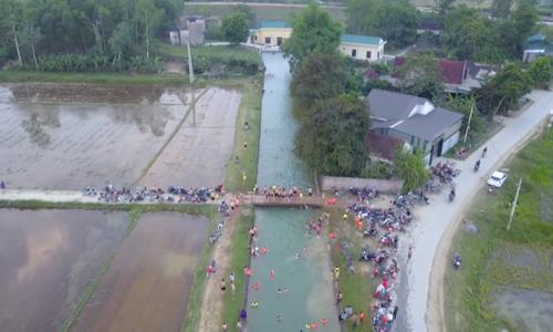 Kids make swimming pool of irrigation canal