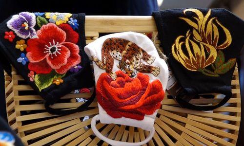 Hanoi needleworkers turn face masks into sharp fashion statements