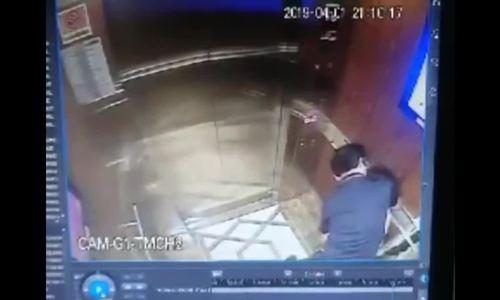Người đàn ông ép hôn bé gái trong tháng máy