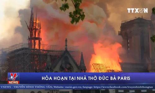 Cảnh tượng lửa bao trùm Nhà thờ Đức Bà Paris, tháp chuông đổ sập