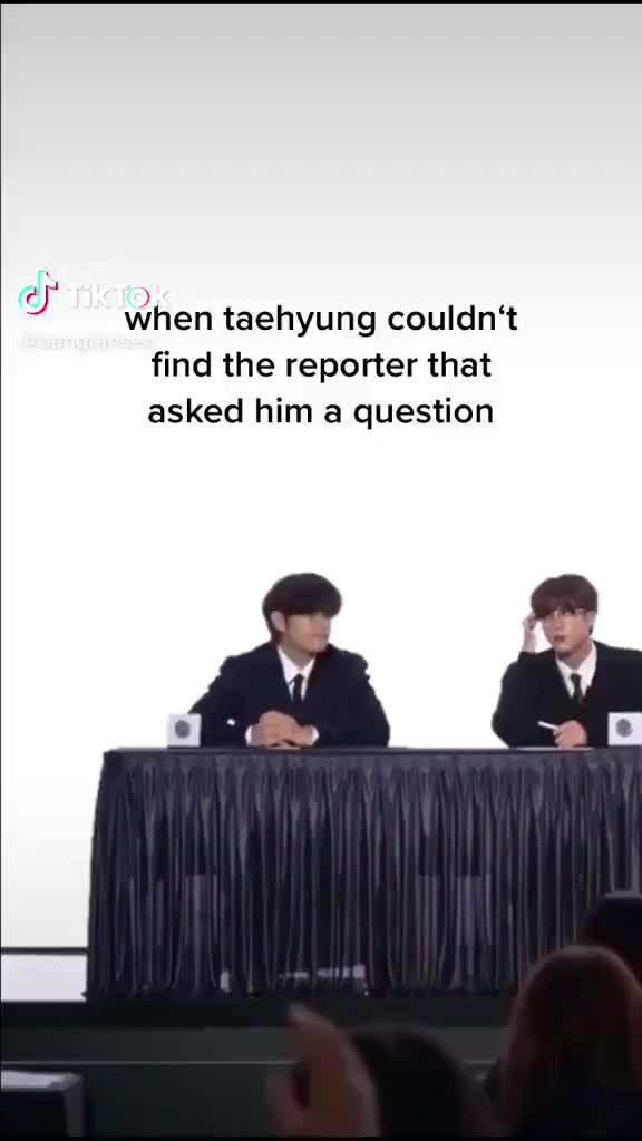 Phản ứng 'dễ cưng như em bé' của V (BTS) trước phóng viên