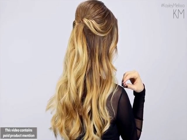 Duyên dáng với lọn tóc xoắn nhẹ nửa đầu