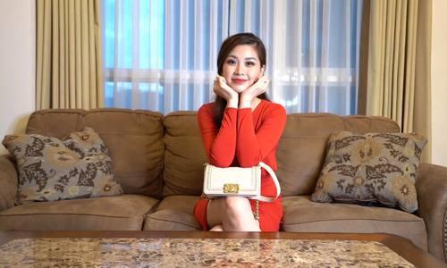 Á hậu Diễm Trang chỉ mang ít tiền trong túi hàng hiệu chồng tặng