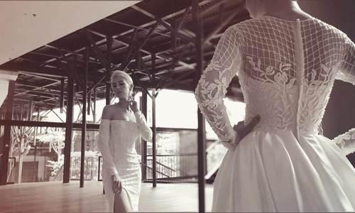 Lê Thanh Hòa thiết kế BST váy cưới cho cô dâu đặt tiệc tại GEM Center