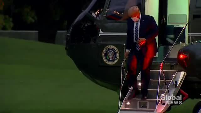 Ông Trump tháo khẩu trang sau khi rời viện