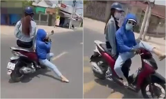 Cô gái vừa lái xe vừa làm xiếc trên đường