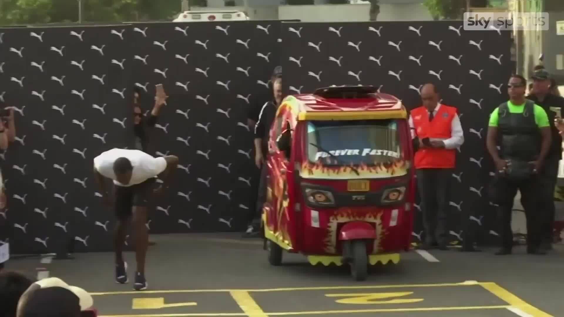 Usain Bolt đọ tài với xe ba bánh