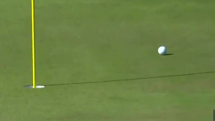 Leishman chip from outside the green recorded birdie
