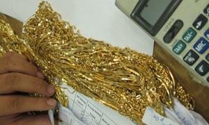 Vận chuyển 2kg vàng lậu từ Hồng Kông về Hà Nội