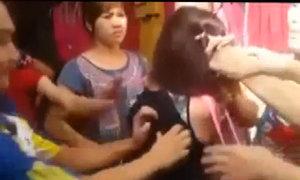Cô gái bị cắt tóc giữa chợ vì bị cho là  trộm điện thoại