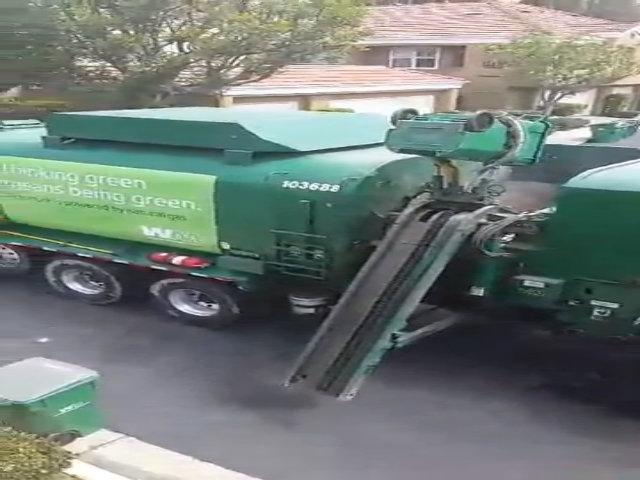 Xe gom rác tự động chạy khí CNG