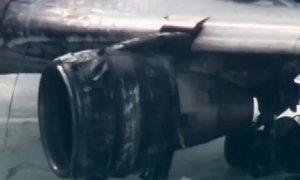 Máy bay chở 101 người bốc cháy trên đường băng