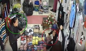 Hai cô gái xông vào bắt giữ nữ quái trộm tiền trong shop