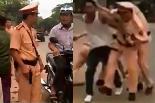 Sau vài phát súng, cảnh sát giao thông quật ngã thanh niên cầm 2 con dao