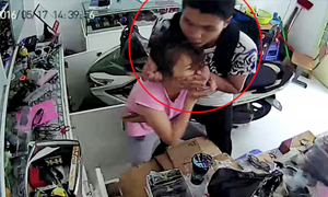 Cô gái chống chọi với tên cướp iPhone 6 dù bị kề dao vào cổ