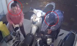 Đôi nam nữ giả vờ trú mưa trộm xe SH ở Hà Nội