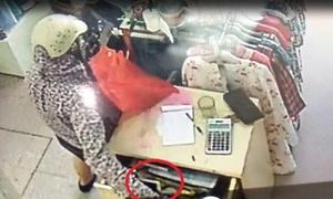 Bà bầu vào shop quần áo trộm điện thoại