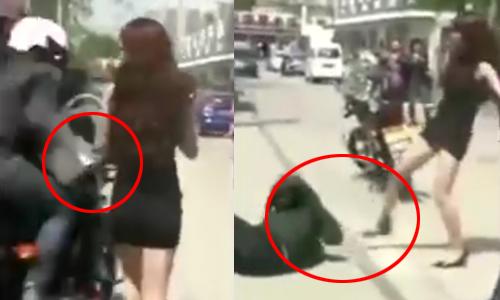 Người đẹp tung cước hạ gục hai tên cướp trên phố