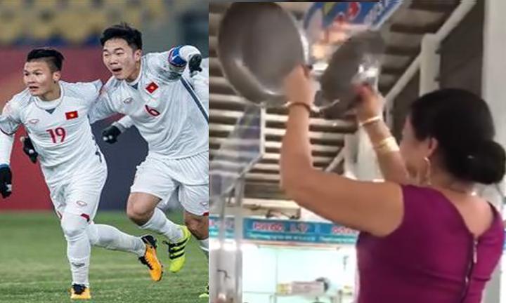 Tiểu thương cầm đĩa cân mừng U23 Việt Nam vào chung kết