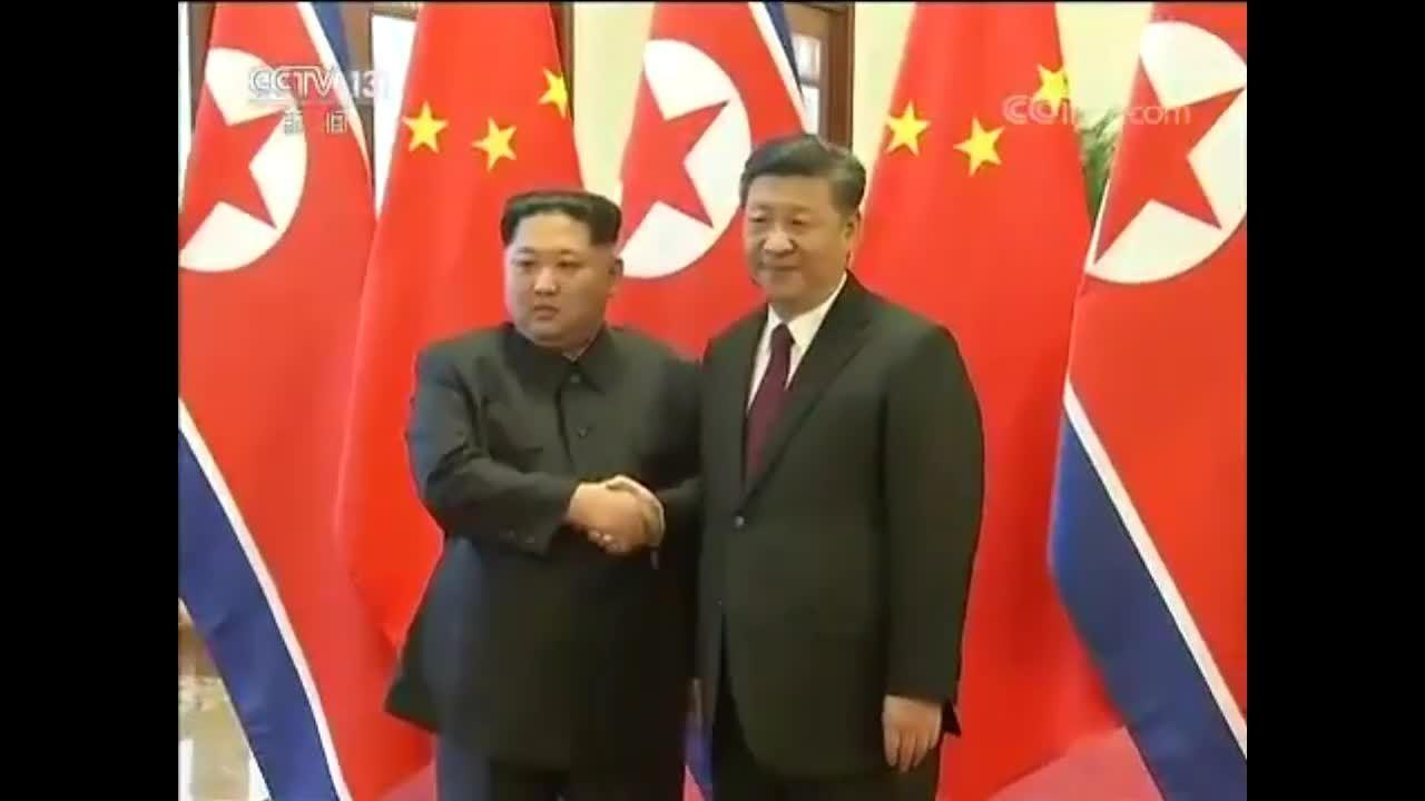 Kim Jong-un và phu nhân bắt tay Tập Cận Bình và phu nhân