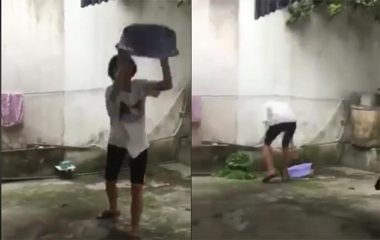 Cô gái vứt rổ vào tường khi trổ tài vẩy rau