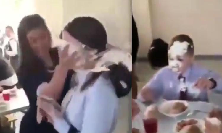 Cậu bé ngơ ngác khi bị bánh kem văng vào mặt